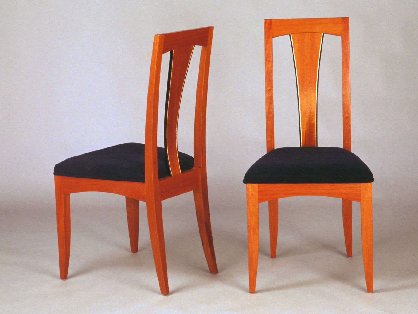 Mahogany dining chairs with inlay